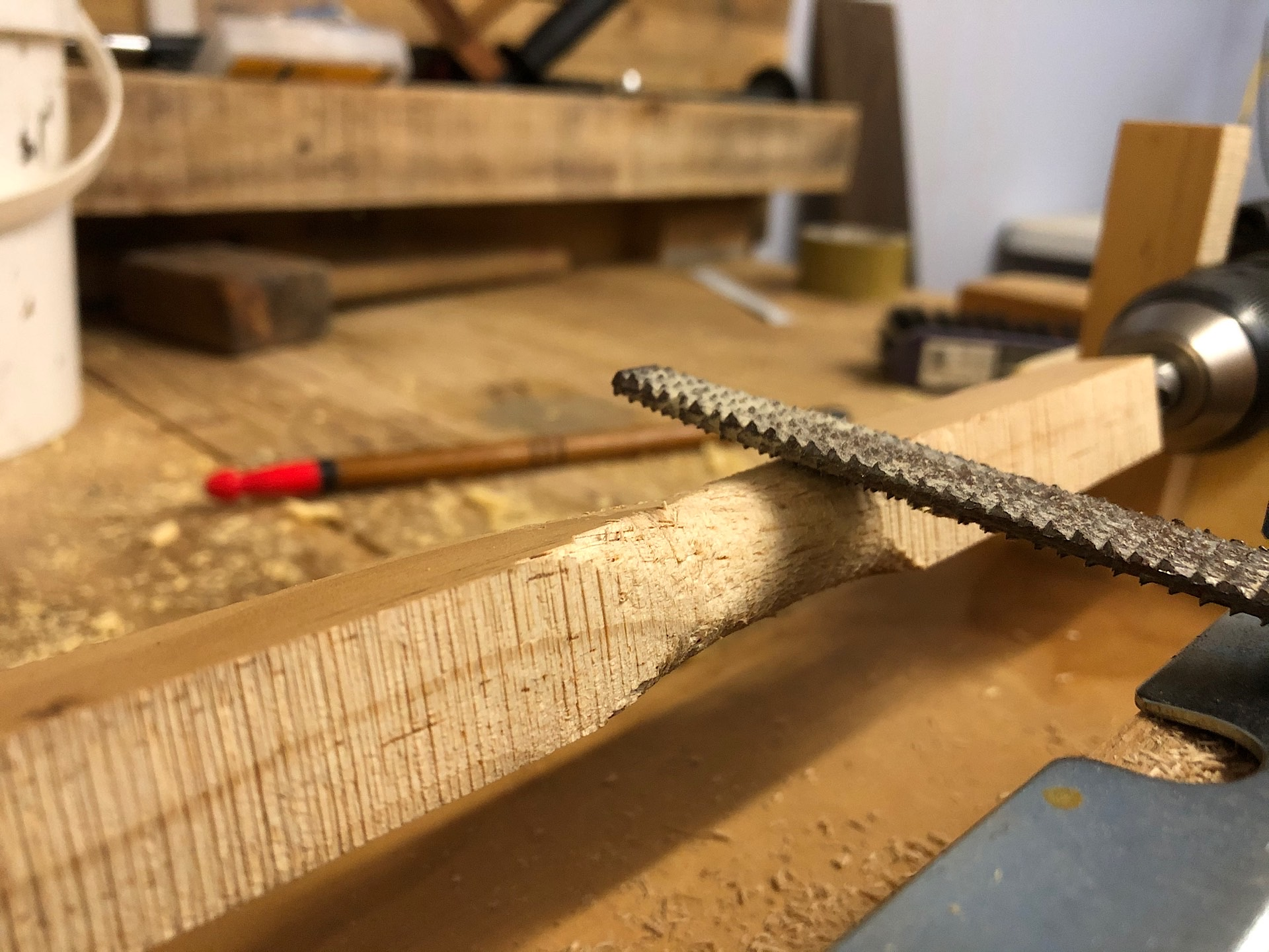 Using a rasp file to turn wood