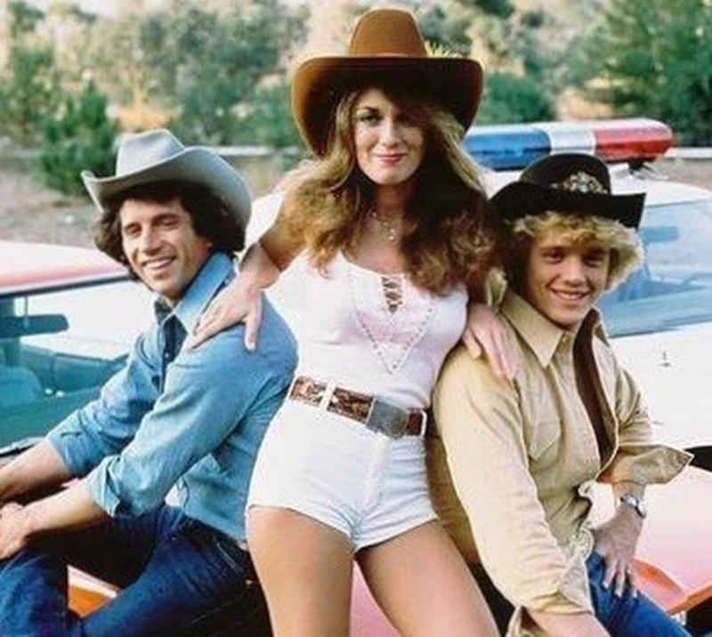 John Schneider, Catherine Bach and Tom Wopat in a promotional portrait.jpg