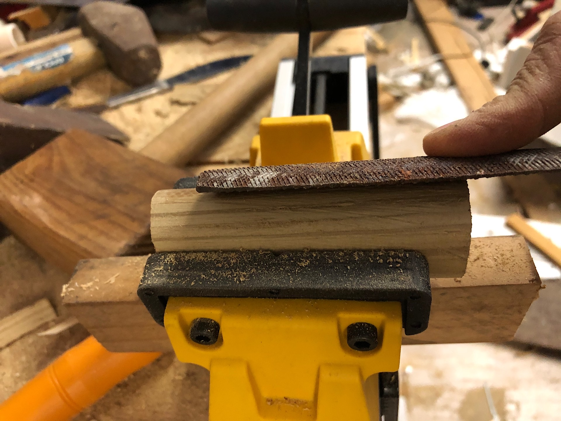 Shaping a knife handle with a file