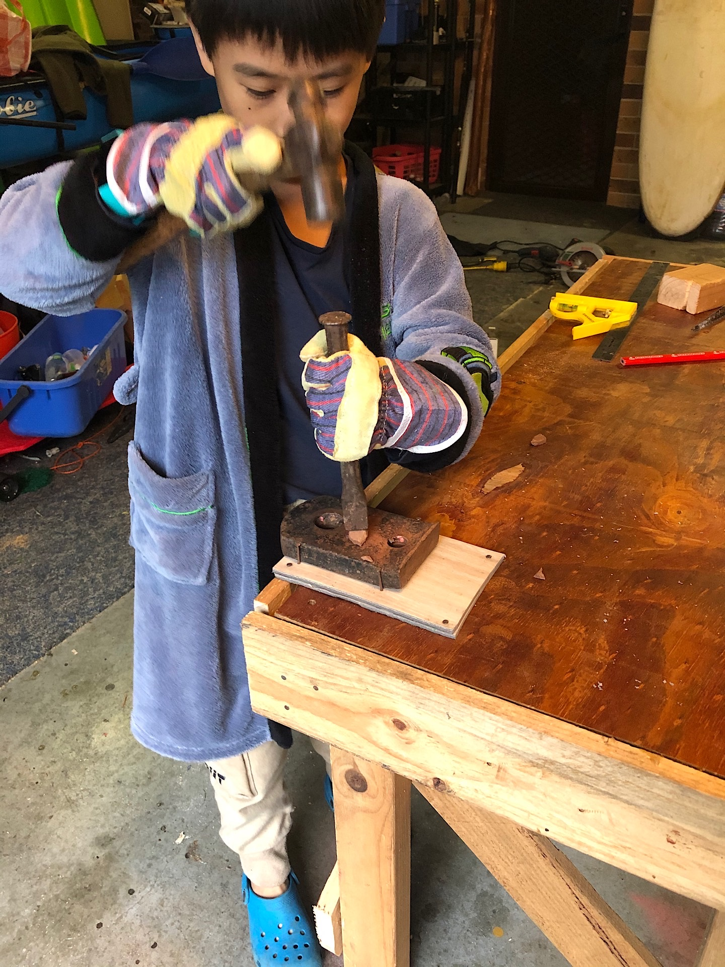 Testing his workbench anvil