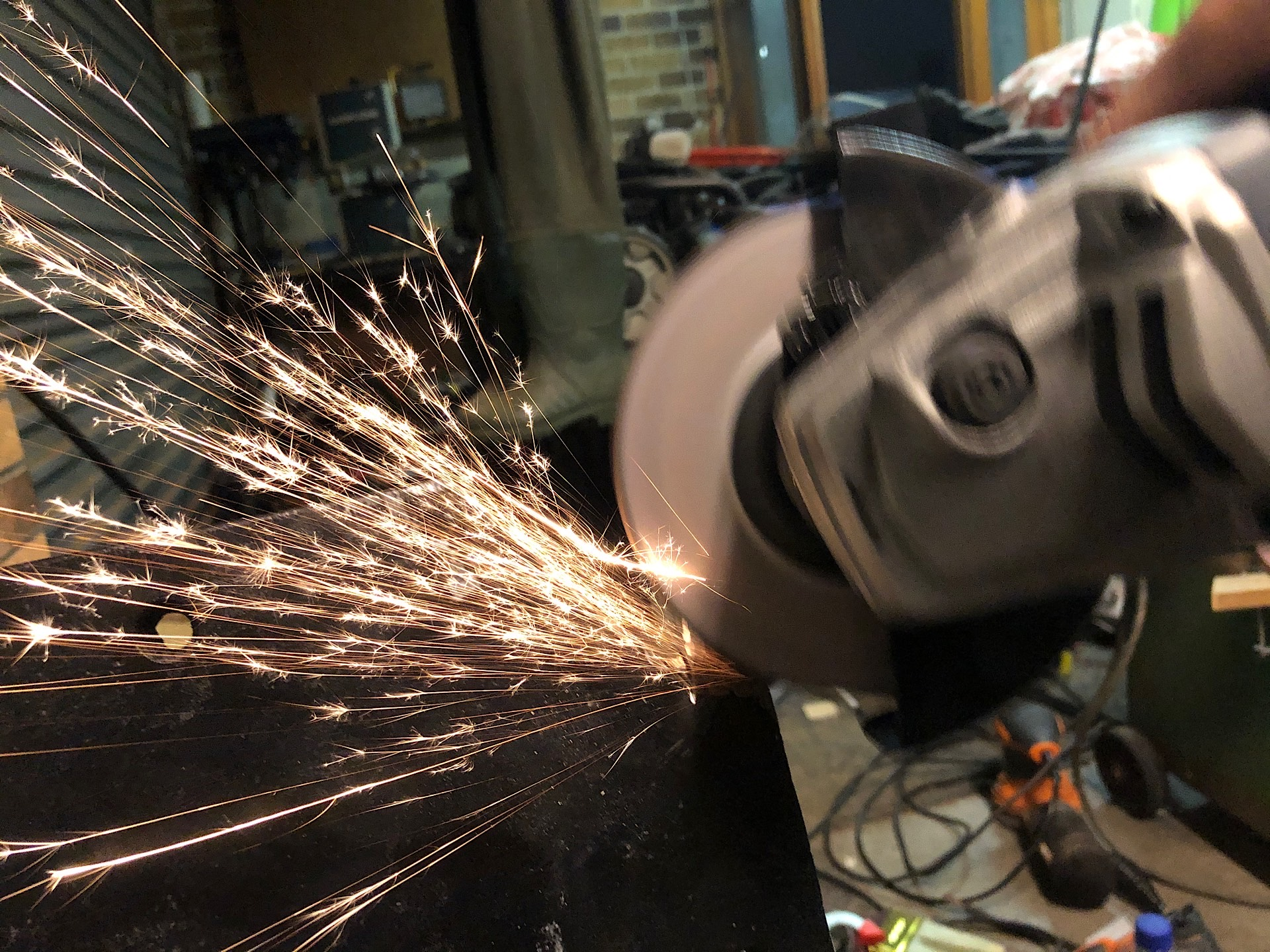 Finishing the cut with an angle grinder