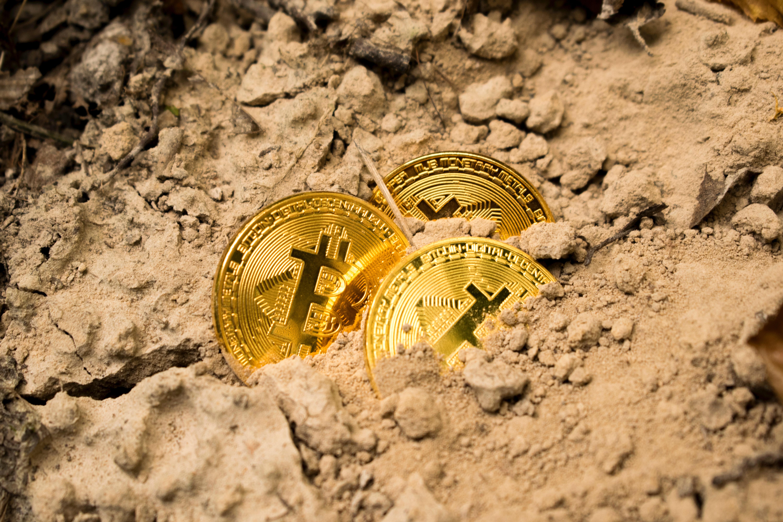 bitcoins in sand unsplash.jpg