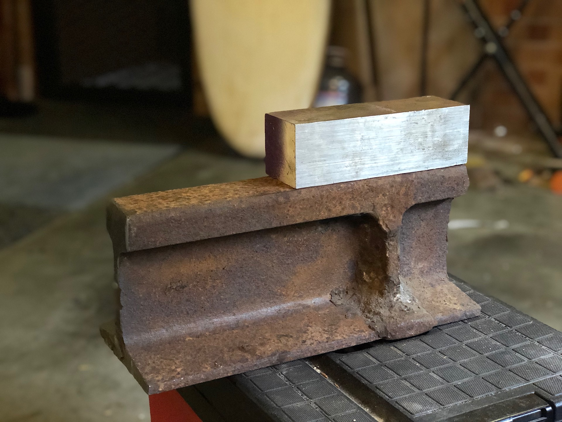 Crane rail track and piece of tool steel
