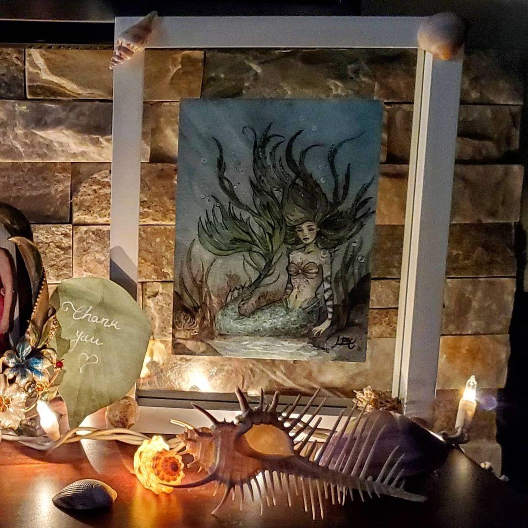 mermaid in her forever home.jpg