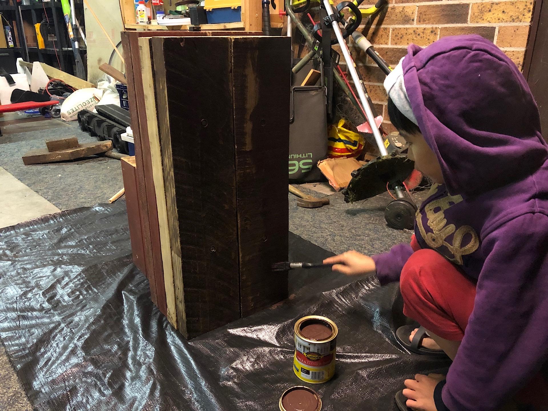 Thiên-San helping me paint he anvil stand