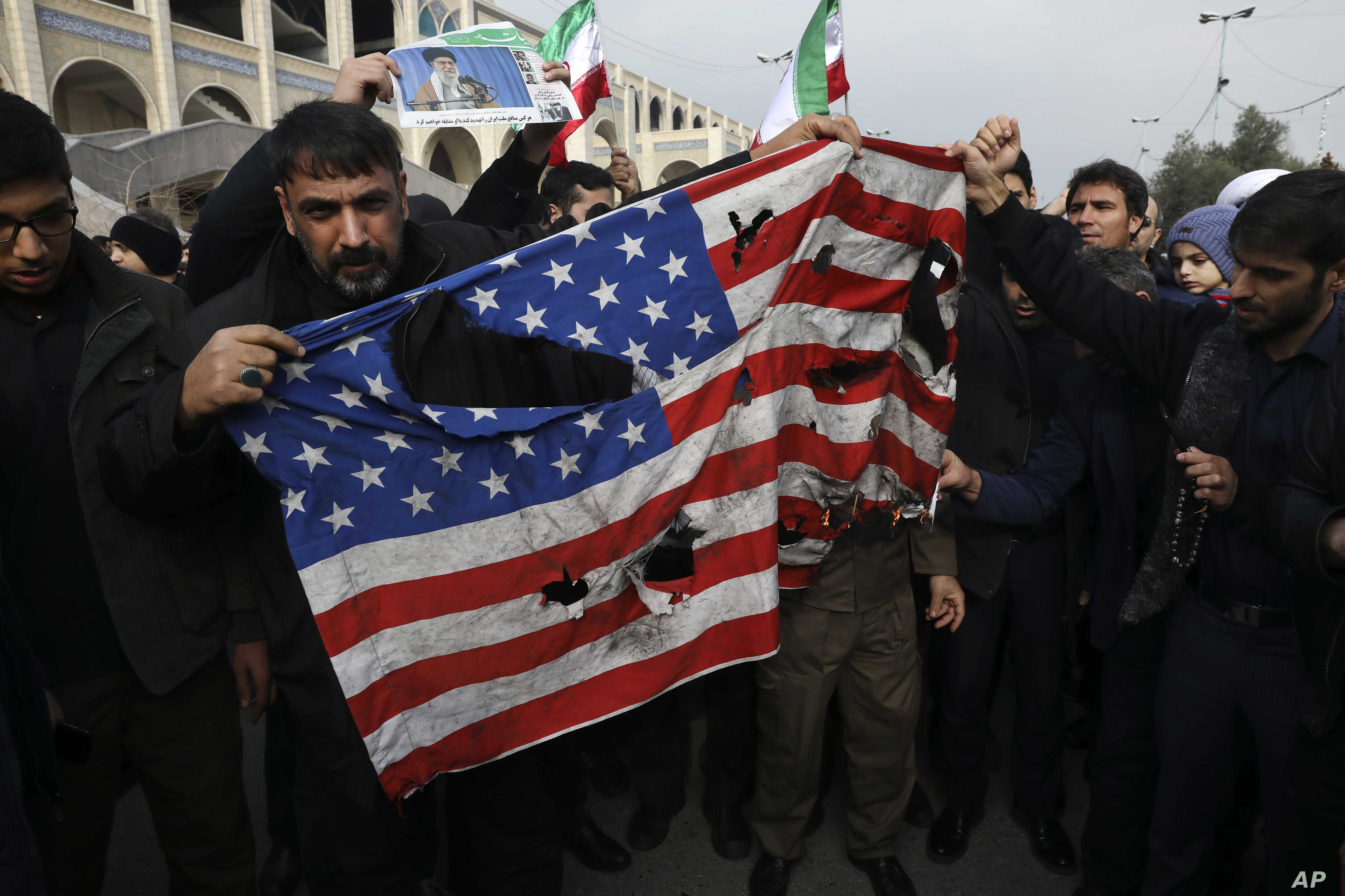 ap_iran_flagimperialismburnterror.jpg