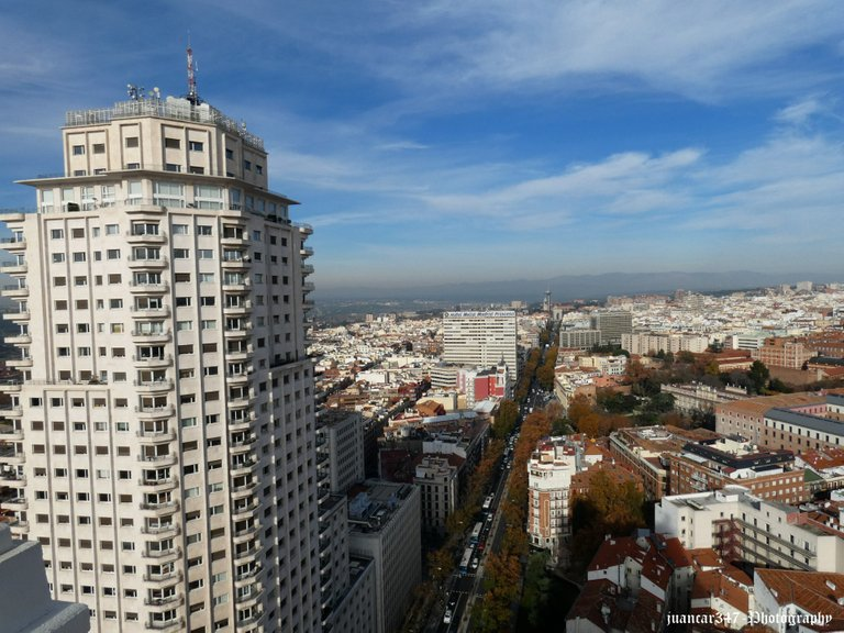 In the foreground, the grandiose Tower of Madrid