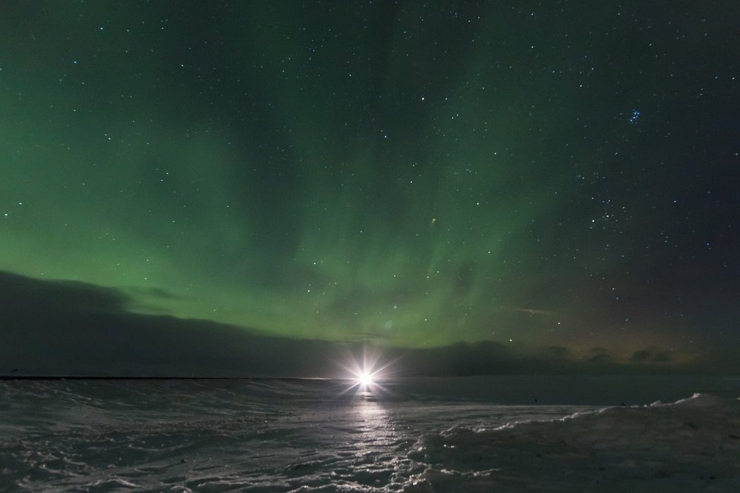 Car lights and northern light