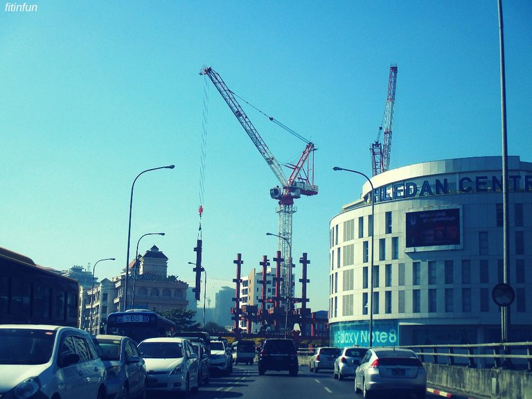 Yangon Myanmar construction crosses axeman fitinfin.jpg