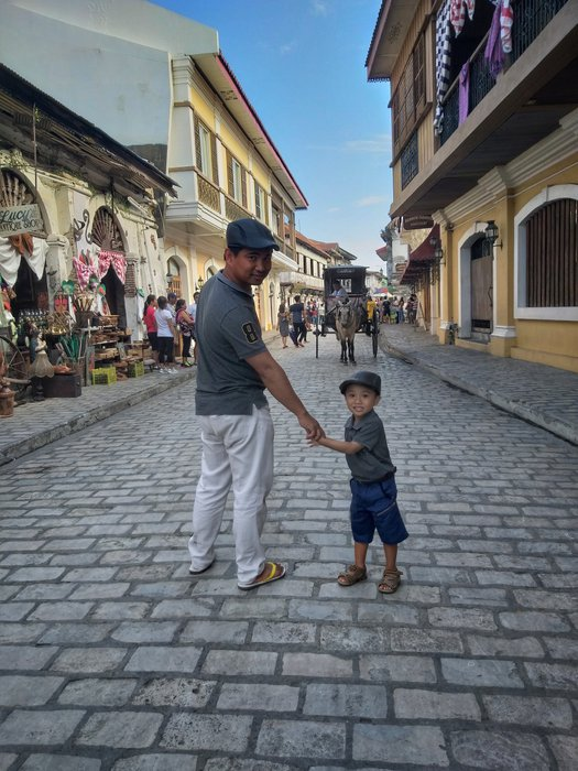 Striking a pose in the most beautiful street of the Philippines