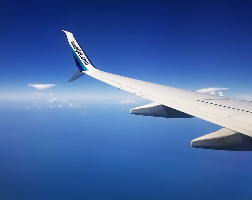 20180622_142759-flying-over-gulf-of-mexico-westjet-plane-1200.jpg