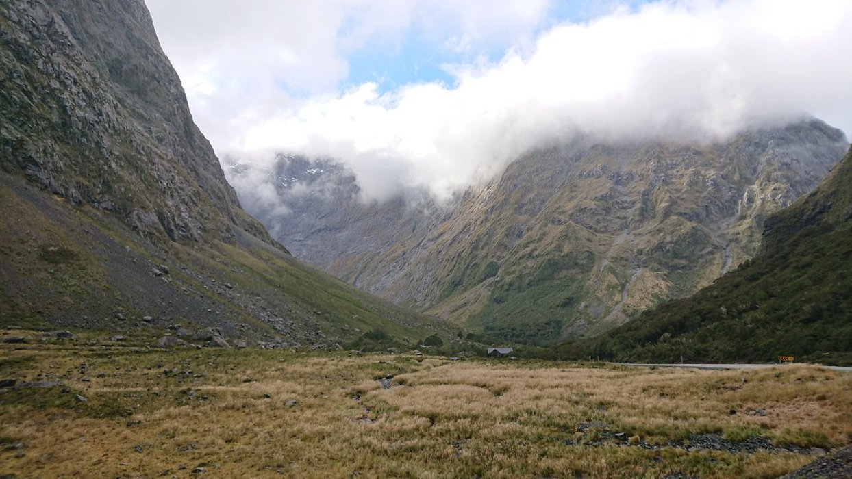 The surrounding ranges shrouded in cloud and mystery