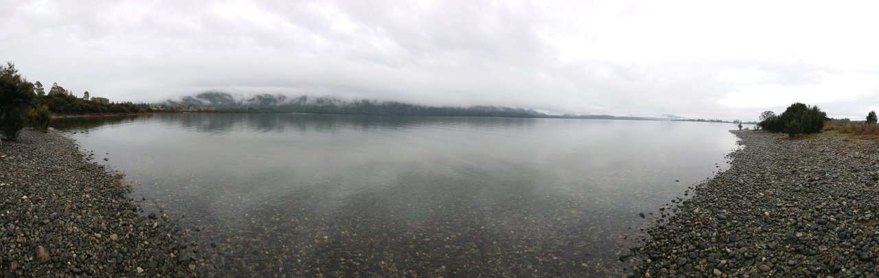Panoramic from the east side of a cloudy Lake Te Anau