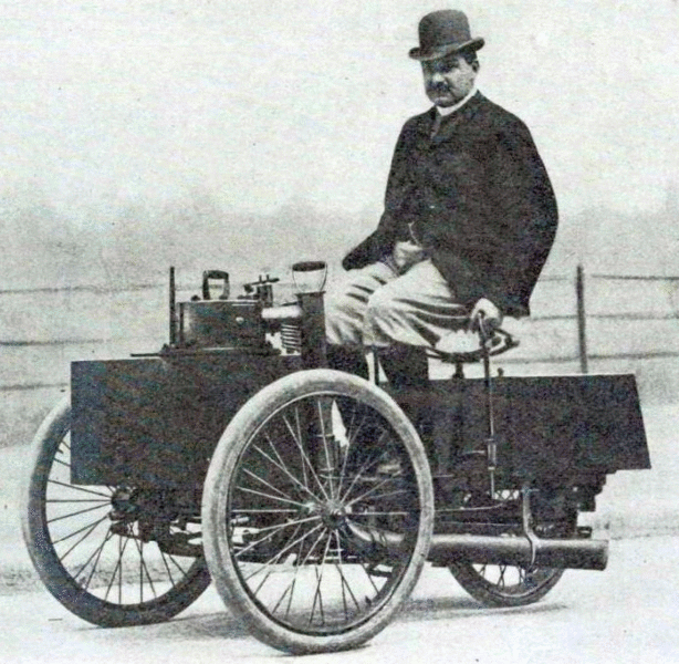 De Dion sitting on his Steam tricycle - Source