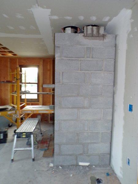 Construction  masonry heater finishing work2 crop June 2020.jpg