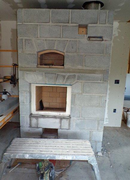 Construction  masonry heater finishing work1 crop June 2020.jpg