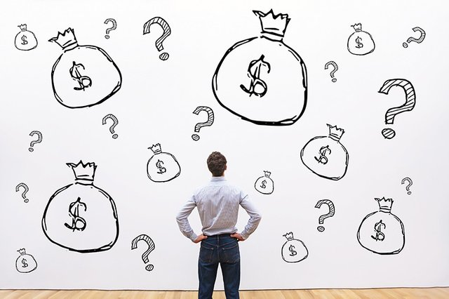 man_contemplating_images_of_money_and_question_marks_on_wall_in_page.jpg