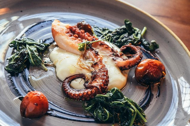 grilled octopus with greens