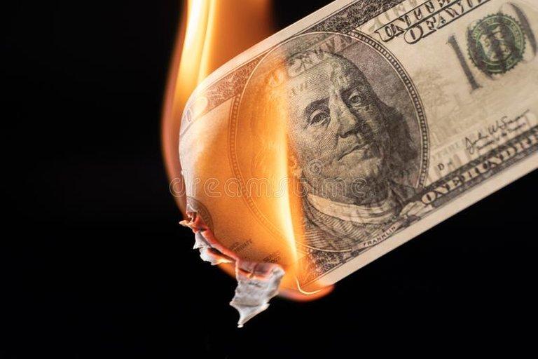 dollar-bill-usa-money-burning-flames-economic-crisis-inflation-concept-178888196.jpg