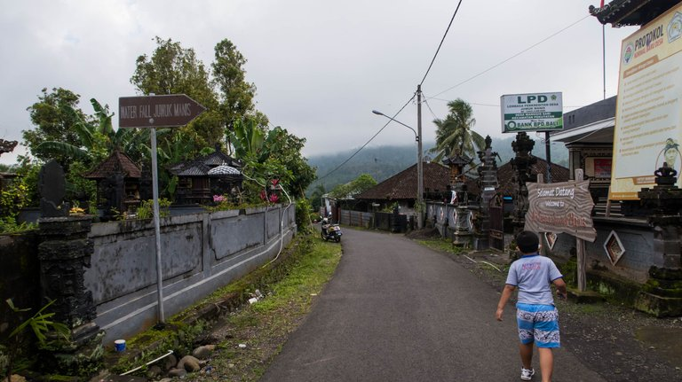 The sign says Waterfall Juwuk Manis to the right.