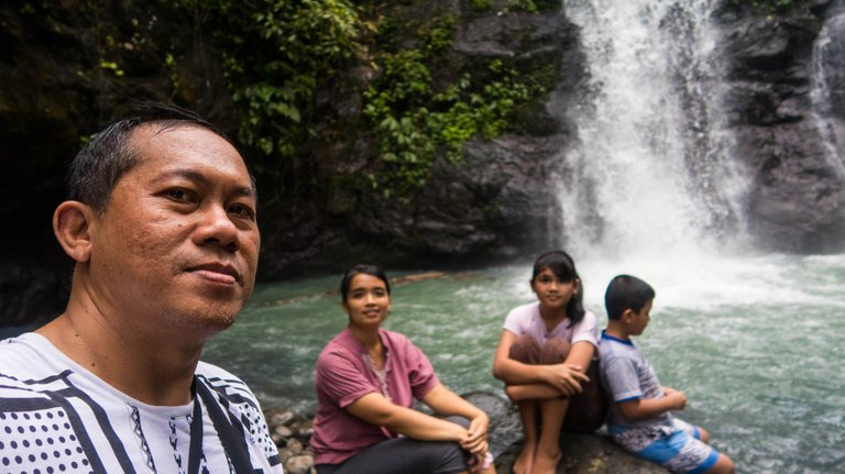 Posing before the waterfall.