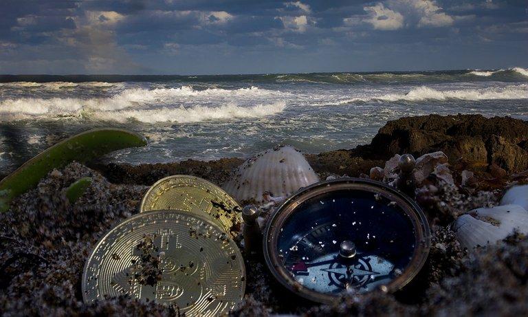 bitcoin in beachsand pixa.jpg