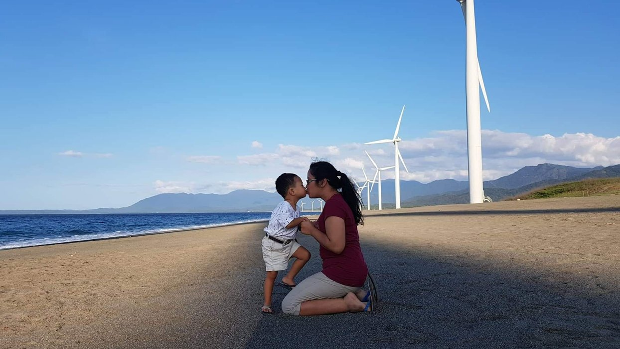 A creative pose with the majestic windmills