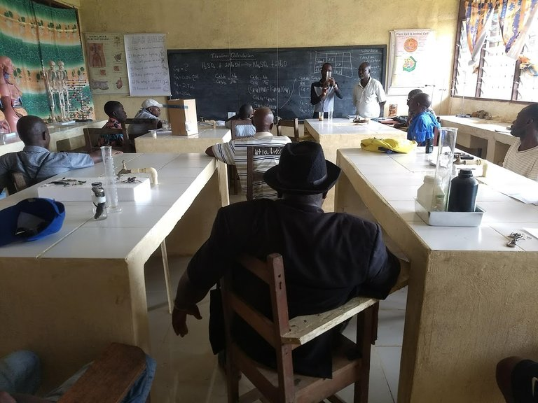 Trained Teachers presenting to special invitees. School Principal, Mr. Shariff, in Black garb