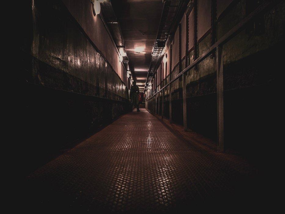 man-standing-in-missile-base-corridor.jpg