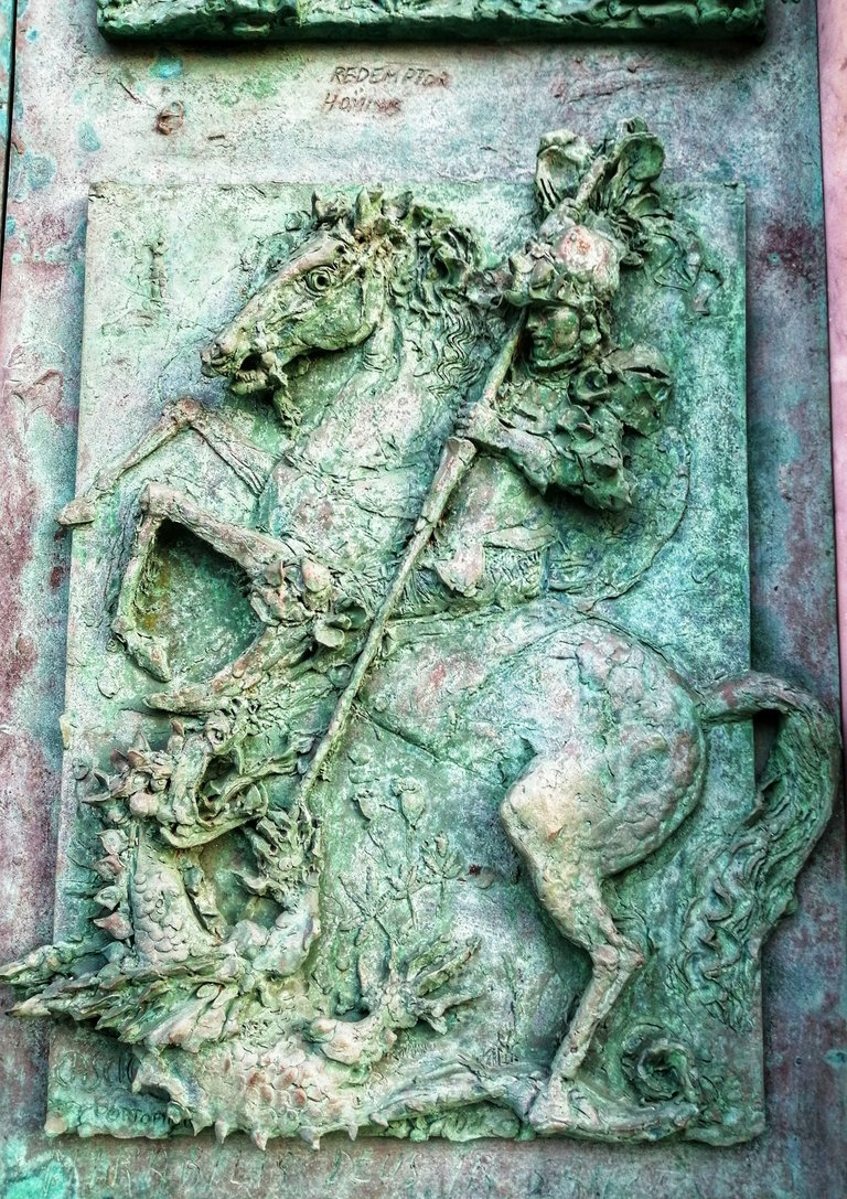 Horse, dragon and dragon hunter bas-relief...