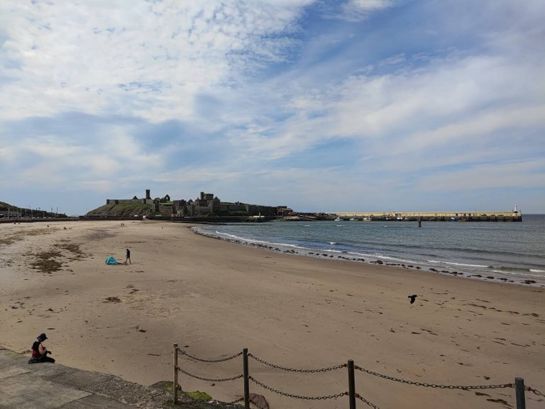 View of Peel beach, with Peel castle and pier in the background