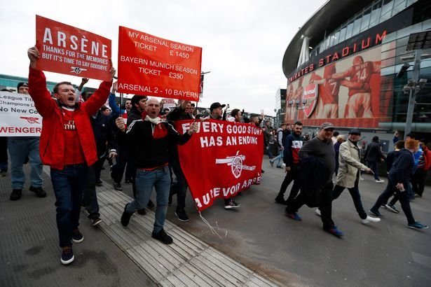 Arsenal-fans-hold-up-banners-protesting-against-Arsenal-manager-Arsene-Wenger-and-ticket-prices-outs.jpg