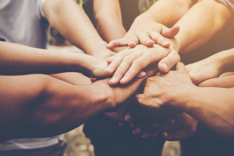 business_teamwork_join_hands_together_business_teamwork_concept.jpg