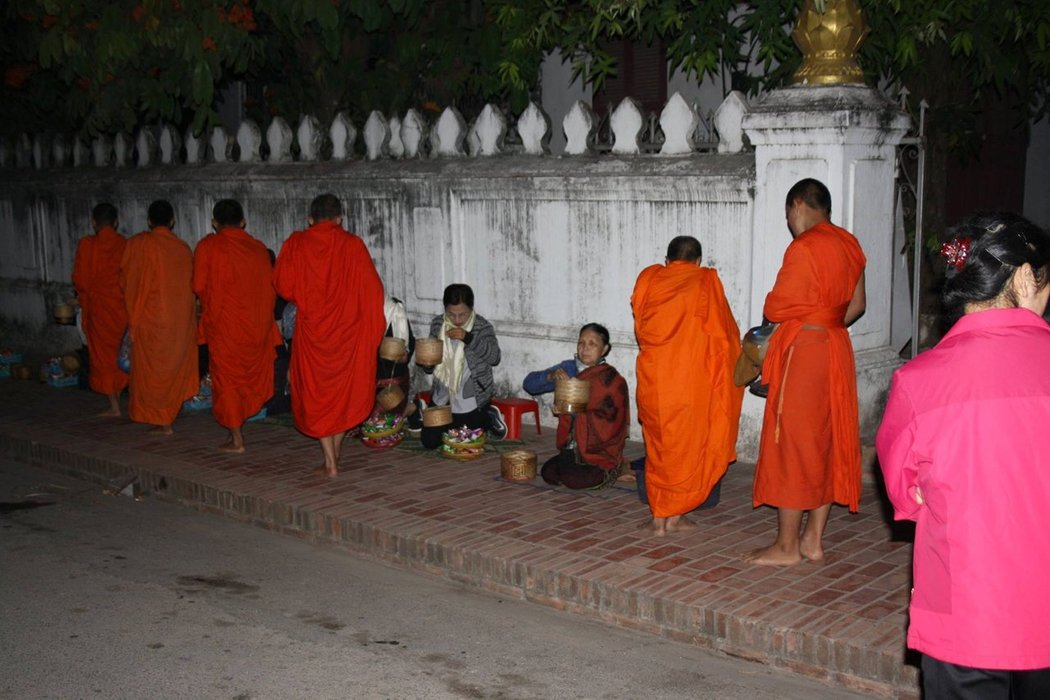 The alms-giving ceremony is a longstanding tradition in Laos Buddhist culture and a sacred ceremony for the locals and the monks.