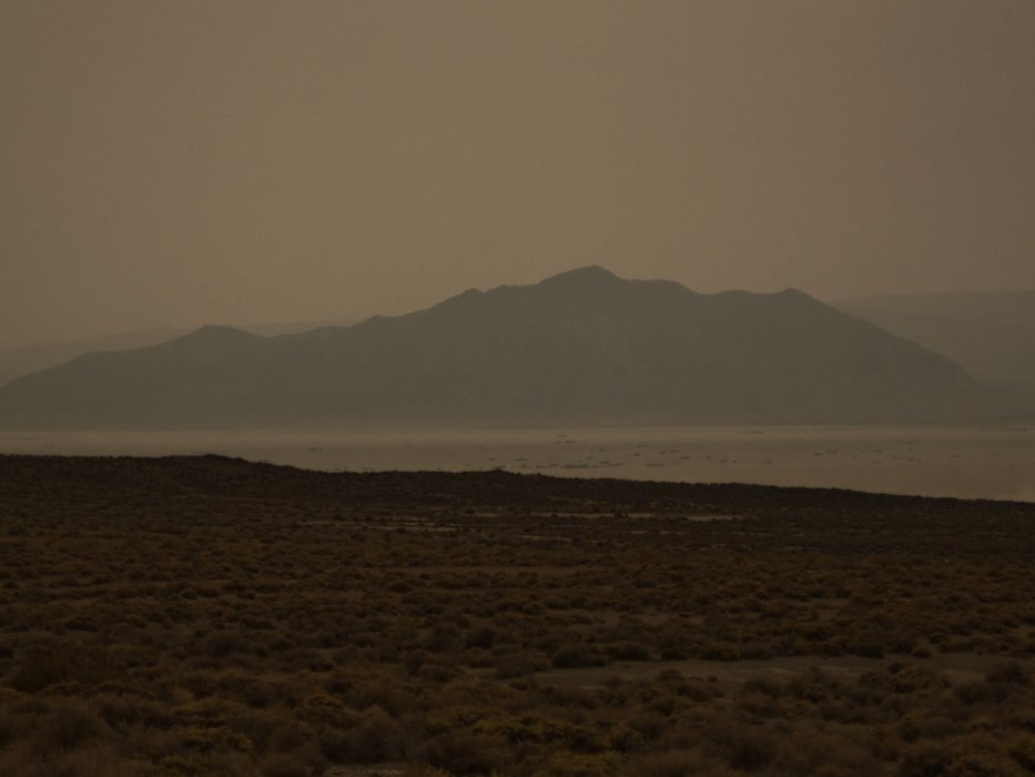 Heavy smoke from the forest fires in California has settled on Black Rock City. Old Sawtooth Mountain in the background.