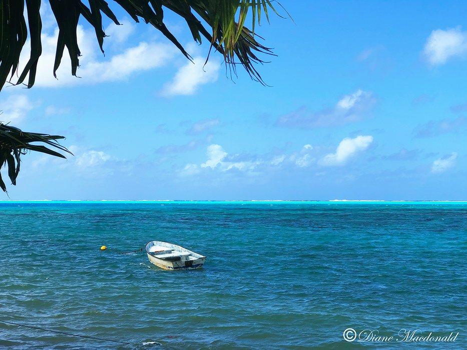 boat in lagoon 2 parea huahine.jpg
