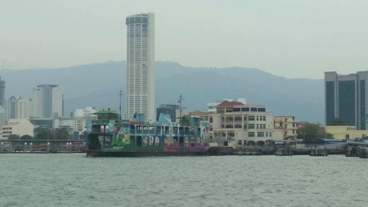 Significance of colorful old ferry and tallest building in the island - Komtar