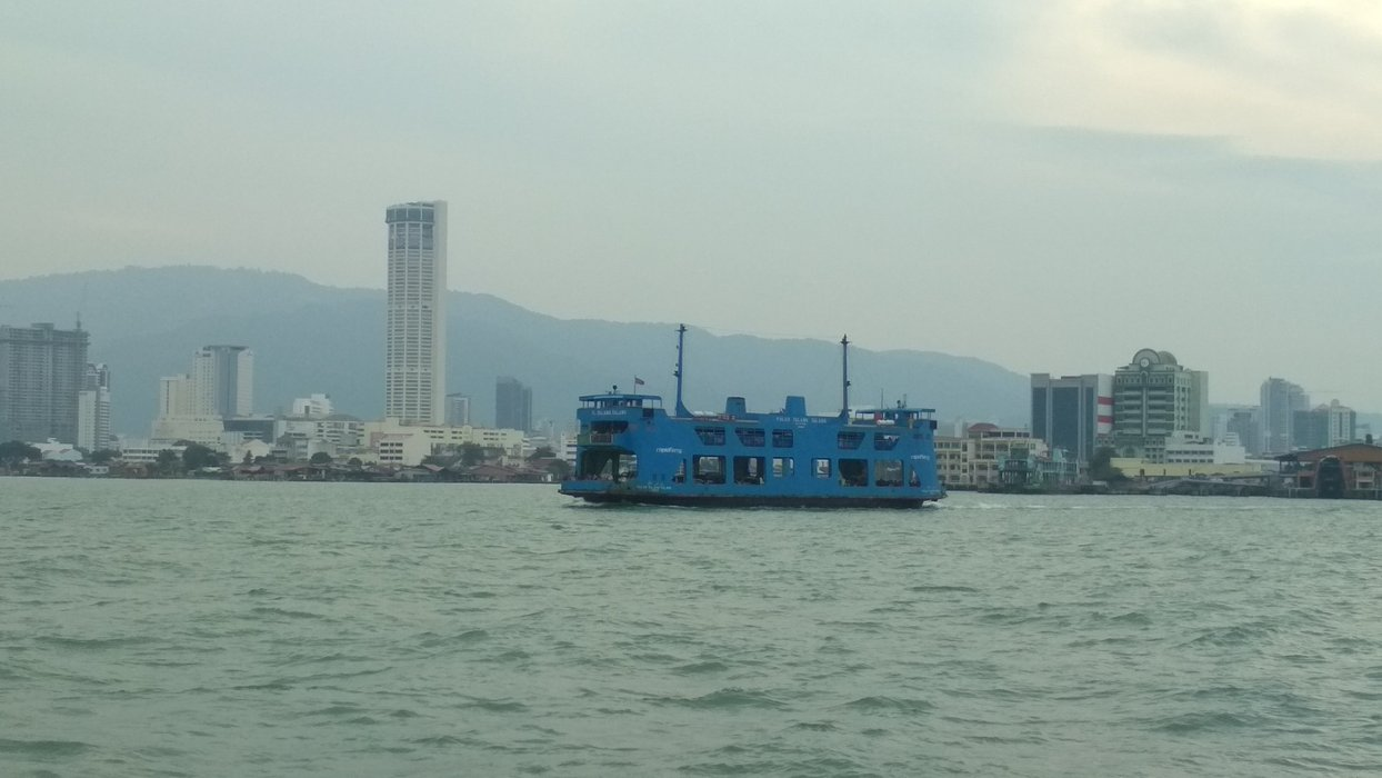 Another blue ferry passing by