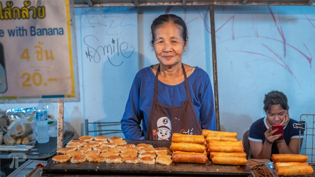Nice local vendor selling pancakes and fried spring rolls for 10 Baht