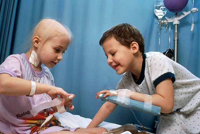 Two girls with acute lymphoblastic leukemia receiving chemotherapy.