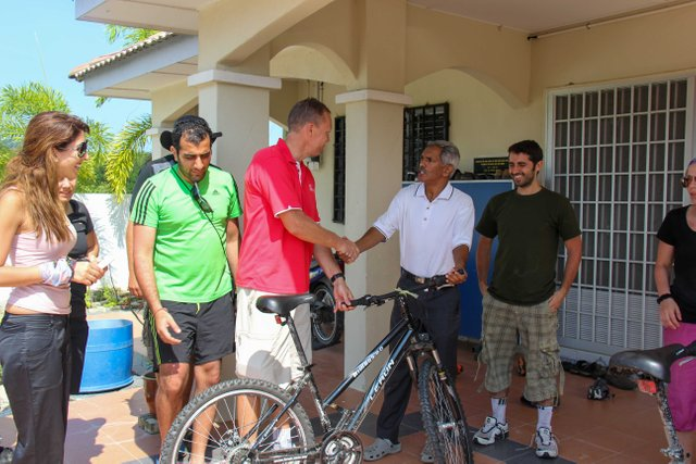 Handing Over the Bicycles