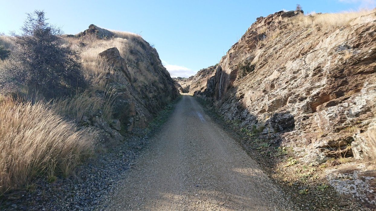 Just before the tunnel, the trail cuts through the rock...