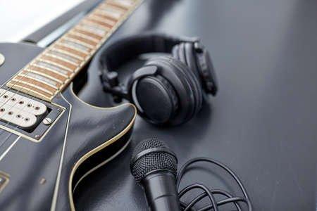 163138867-close-up-of-bass-guitar-microphone-and-headphones.jpg
