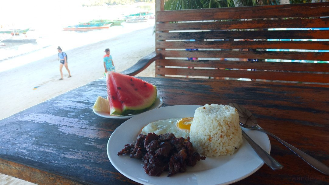 Tapsilog and fruits for breakfast
