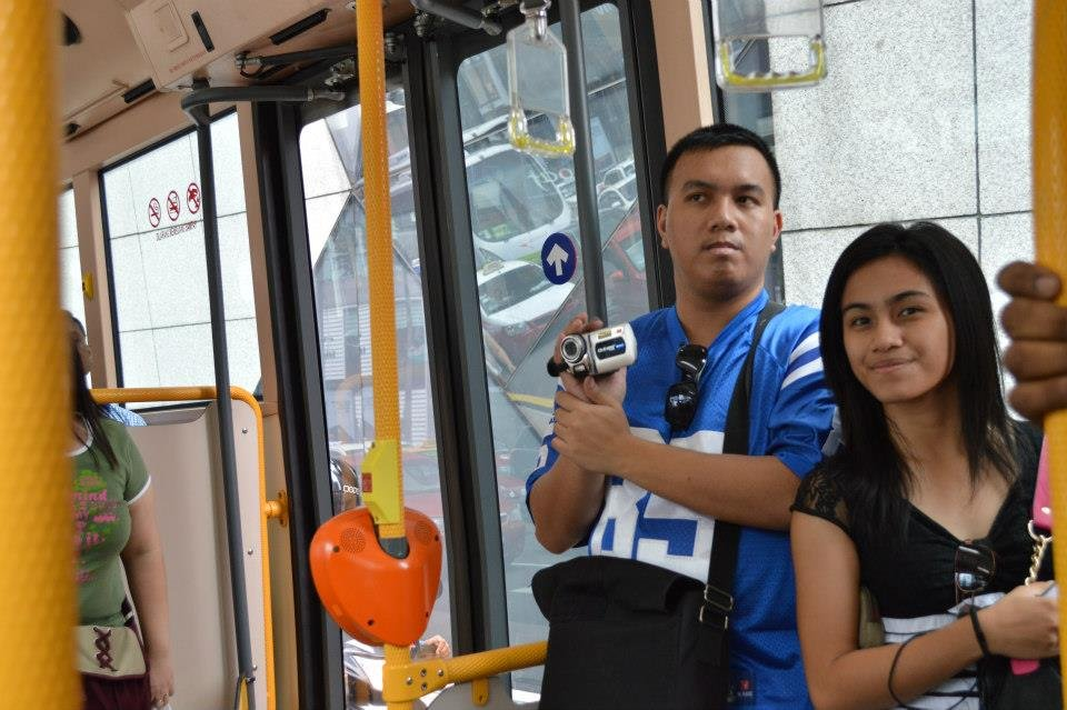 This is me holding my camcorder during our bus ride with my youngest sister Kookee in Malaysia