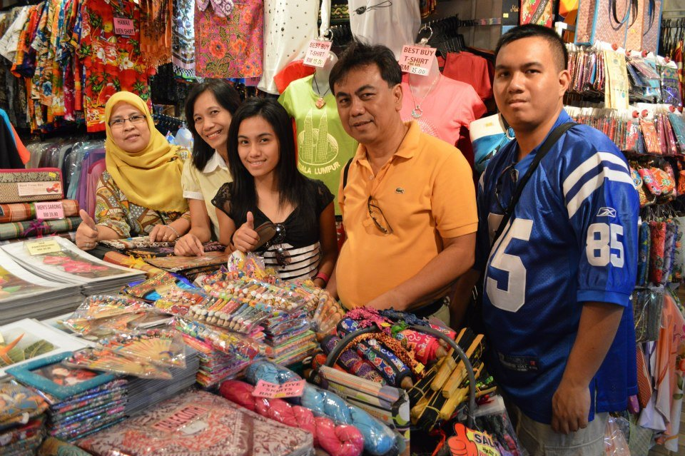 Encountering a Muslim woman, who is indeed a Filipina working in Central Market Malaysia.