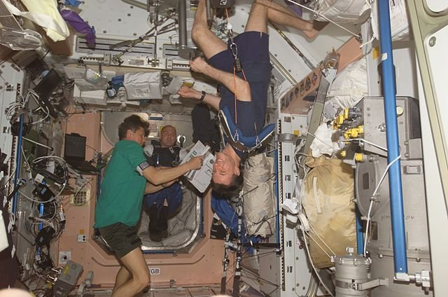 Astronauts on the International Space Station experience only microgravity and thus display an example of weightlessness. Michael Foale can be seen exercising in the foreground.