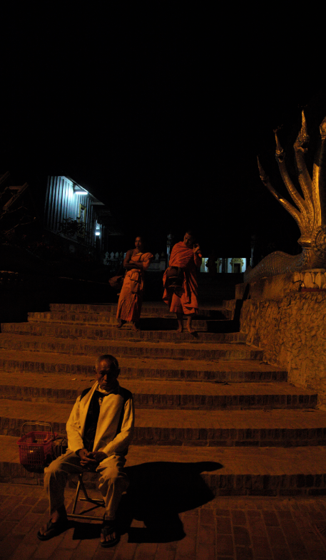 The elderly sit at his chair to wait the monk come
