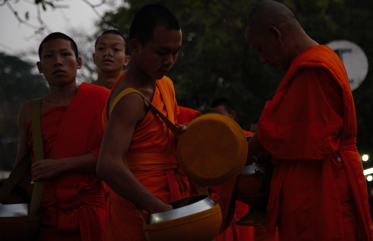 Giving the important gift to the head monk