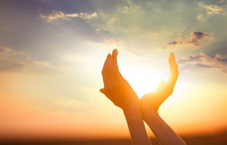 hands-held-up-to-sun.jpg
